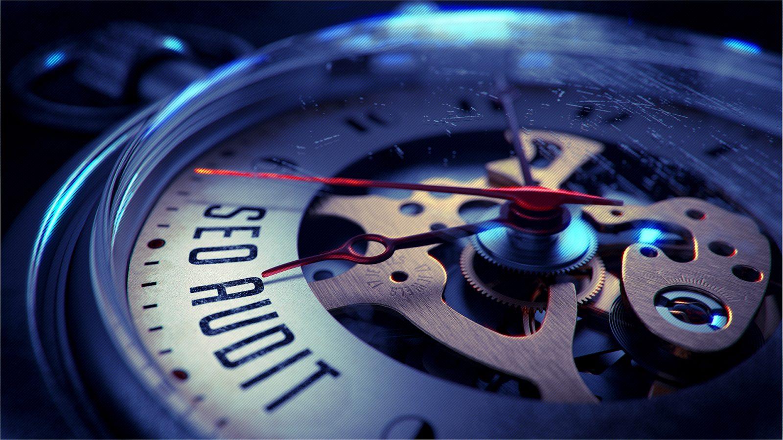 Часовой механизм с надписью SEO аудит
